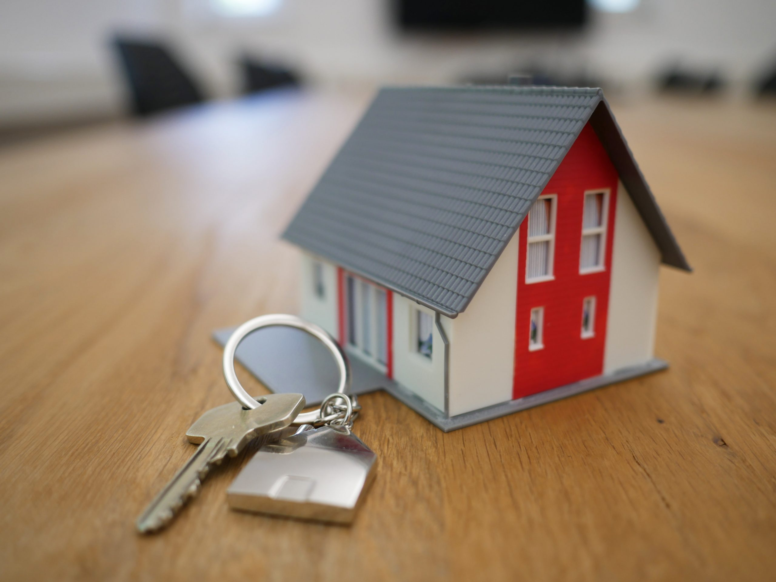 How a pre-sue report can help recover a debt - house picture shown as a major asset for debt recovery